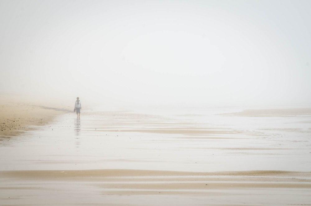My mom walking on the beach